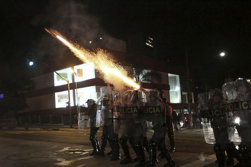 Military police fire tear gas at demonstrators of the group called Black Bloc during a protest against Sao Paulo State Governor Geraldo Alckmin, in Sao Paulo on July 30, 2013. -- PHOTO: REUTERS