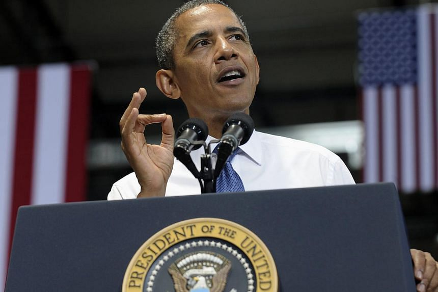 "President Barack Obama gestures as he speaks at the Amazon fulfillment centre in Chattanooga, Tennessee, on Tuesday, July 30, 2013. US President Barack Obama on Tuesday offered to lower corporate tax rates in exchange for simplifying a code ""riddled"