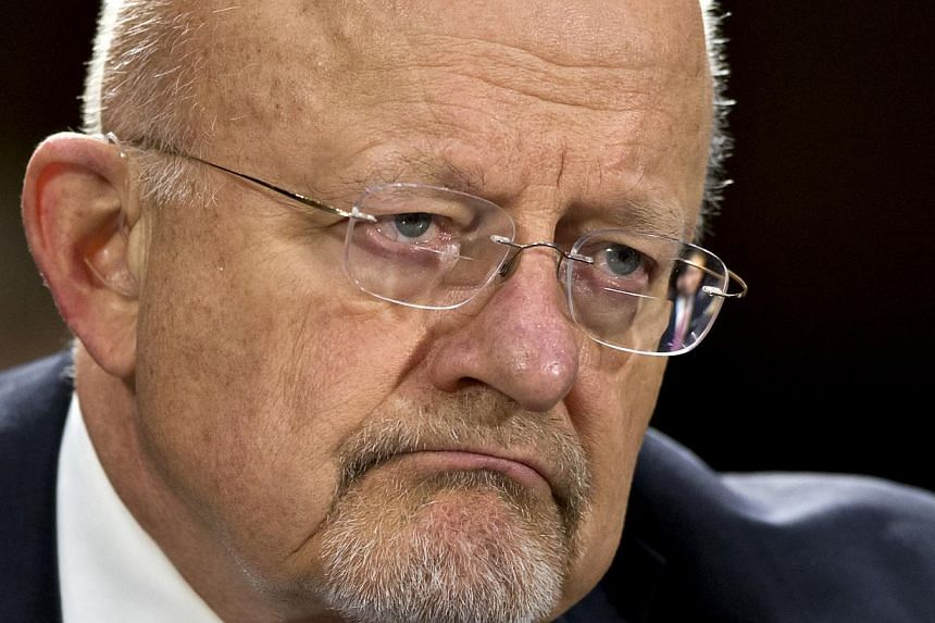 This April 18, 2013 file photo shows National Intelligence Director James Clapper testifying on Capitol Hill in Washington. The declassified documents were intended to provide the public more information about the programmes as part of a commitment b