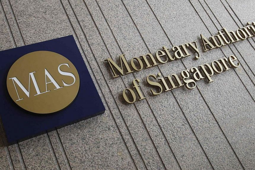 The logo of the Monetary Authority of Singapore (MAS) is pictured at its building in Singapore in this Feb 21, 2013 file photo. Bank lending in Singapore continued to rise at a healthy pace last month, climbing 17.7 per cent to $532.5 billion from a
