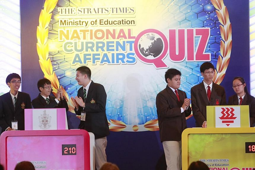 The team from Raffles Institution (left) rejoices after emerging tops with a score of 210 in the finals of The Straits Times-Ministry of Education National Current Affairs Quiz at the Grand Copthorne Waterfront Hotel on Wednesday, July 31, 2013.