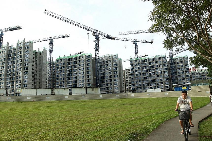 HDB Build-To-Order (BTO) flats under construction at Sengkang Central. Barely a day after the latest BTO launch and there were already about 16 applications from singles for every two-room flat on offer. -- ST FILE PHOTO: SEAH KWA