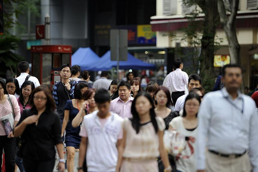 Office workers commmute during the morning rush hour in Singapore's central business district, on Friday, Dec. 16, 2011. Unemployment rose to 2.1 per cent and more workers lost their jobs in the second quarter of the year, even as employment growth s
