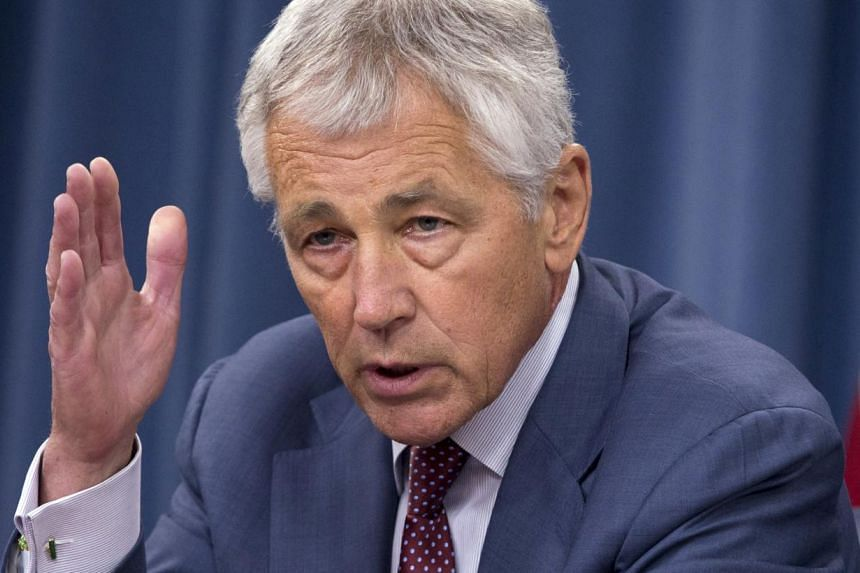 Defence Secretary Chuck Hagel speaks during a news conference at the Pentagon on Wednesday, July 31, 2013. Mr Hagel pledged to cut the Pentagon's overhead by almost US$40 billion (S$50.8 billion) over the next decade and chart out ways to cut compens