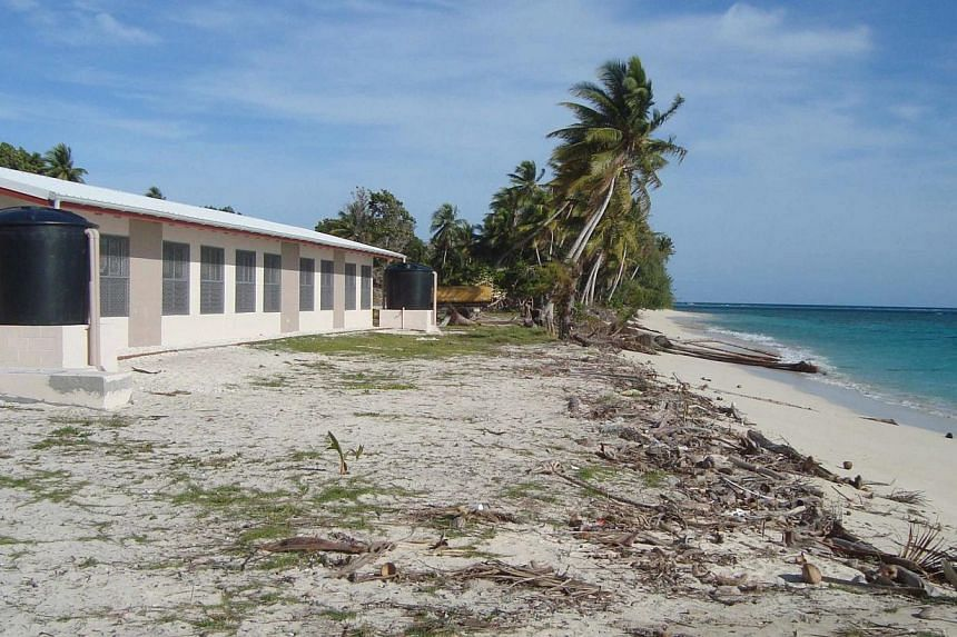 "This undated pictured provided by the office of environmental planning and policy coordination shows the effects of the climate change at Marshall Islands atoll of Ailinglaplap. The Marshall Islands has warned of a Pacific ""climate catastrophe"" that"