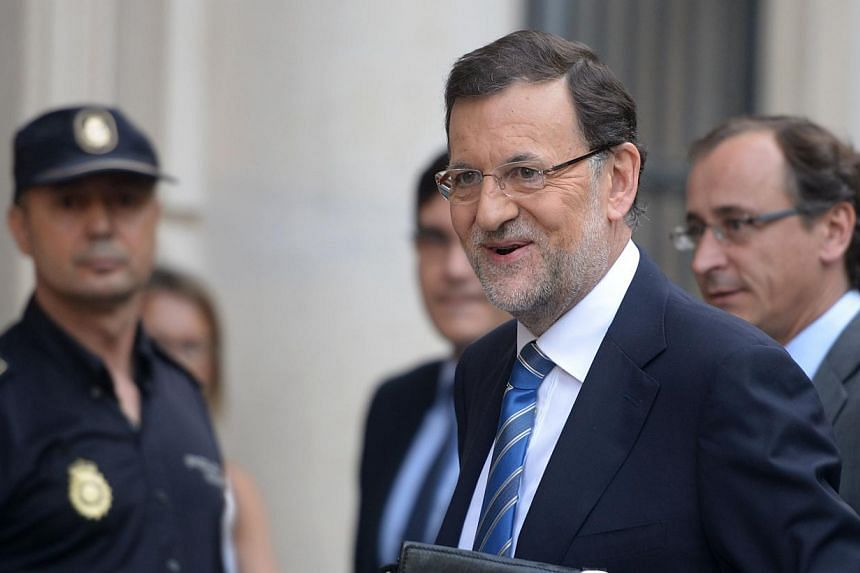Spanish Prime Minister and Popular Party (PP) leader Mariano Rajoy arrives at the Parliament prior to appearing before a special session over allegations that he received illegal payments from his party in Madrid on Thursday, Aug 1, 2013. Mr Rajoy ad