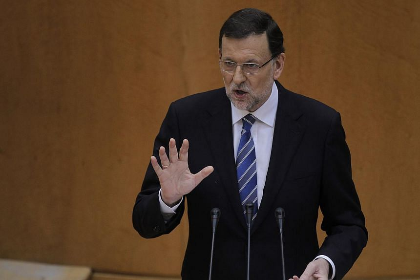 Spain's Prime Minister Mariano Rajoy speaks during a Spanish Parliament session in Madrid, Spain on Thursday, Aug 1, 2013. Mr Rajoy rejected calls on Thursday for him to resign and call snap elections over allegations that he received corrupt payment