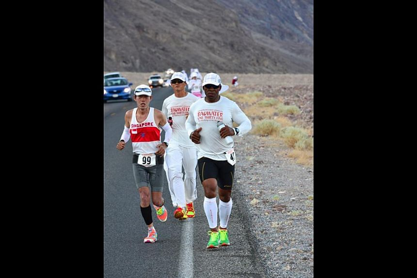 Mr Lim with Badwater Ultramarathon director Chris Kostman.  Mr Lim Nghee Huat (left) starting his ultramarathon in Death Valley National Park, California. Behind him is one of his support crew, Mr Yong Yuen Cheng, 42. On the right is fellow competito