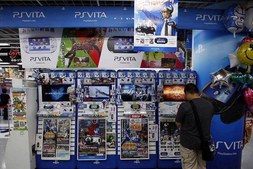 A customer plays a game on Sony's PlayStation Vita at an electronics store in Tokyo on Thursday, Aug 1, 2013. The Japanese electronics giant said on Thursday it swung back to a net profit of US$35 million (S$44.5 million) for the April-June quarter,