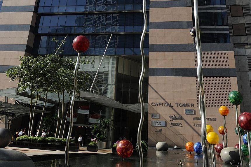The CapitaLand group of companies, now operating from several office locations in Singapore, will all move to the group's corporate headquarters in Capital Tower by 2015. -- FILE PHOTO: BLOOMBERG