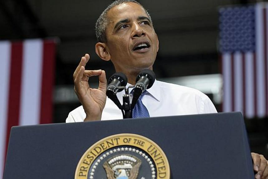 President Barack Obama gestures as he speaks at the Amazon fulfillment center in Chattanooga, Tenn., on Tuesday, July 30, 2013. President Barack Obama acknowledged the problems facing the US newspaper industry on Wednesday, ironically in an inte