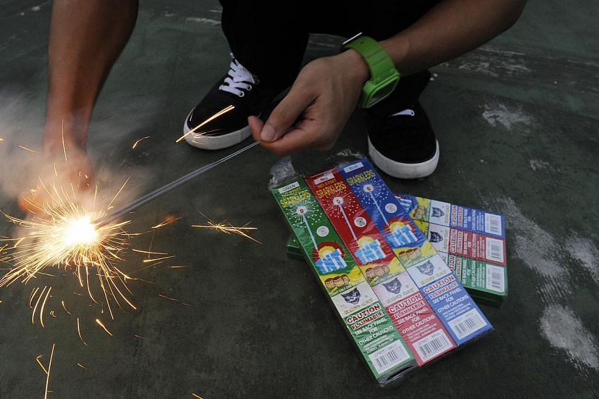 The police said they will be taking a tough stand against the use of sparklers to set off improvised explosive devices. -- ST FILE PHOTO: SAM CHIN