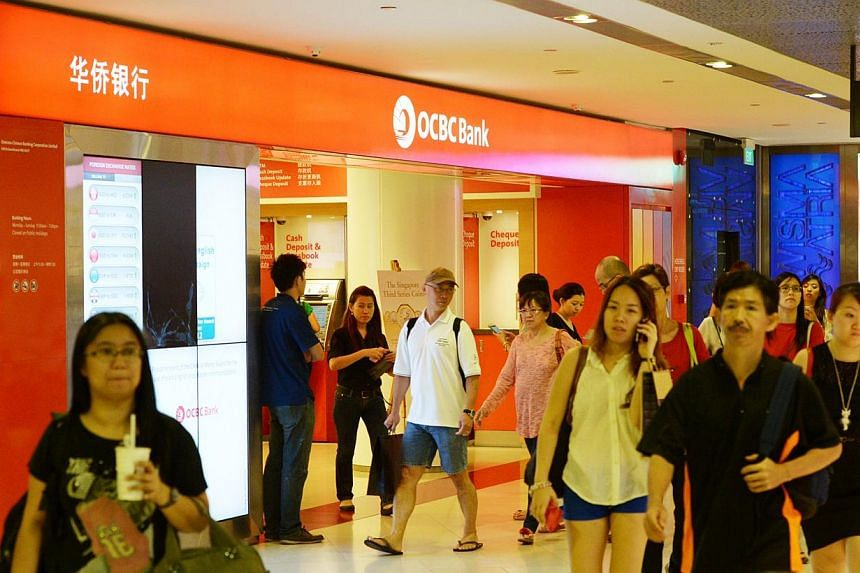 OCBC Bank yesterday reported a second-quarter net profit of $597 million, a 8 per cent slide from the same quarter a year ago, below analysts' forecast of $643 million. -- ST FILE PHOTO: DESMOND WEE