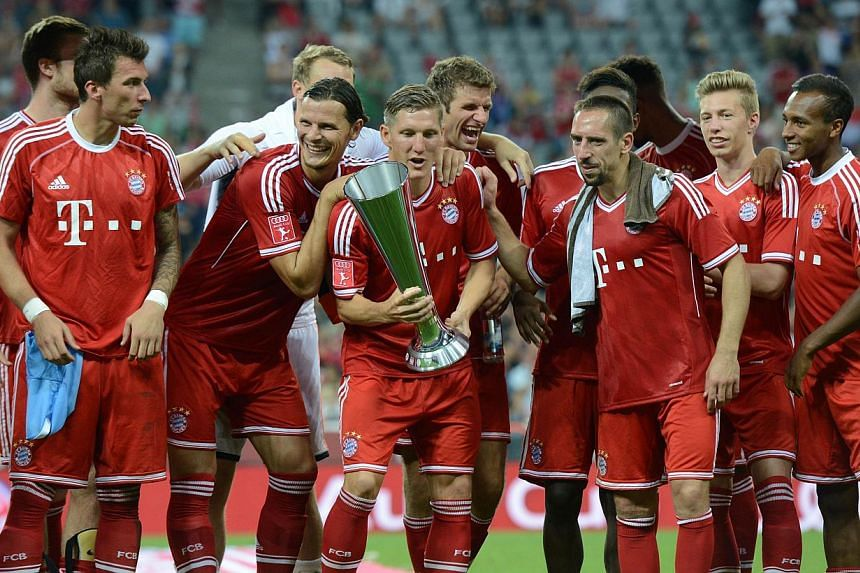 The team of FC Bayern Munich celebrate with the trophy after the Audi Cup football final match FC Bayern Munich v Manchester City in Munich, southern Germany on Aug 1, 2013. Bayern Munich came from a goal down to beat Manchester City 2-1 in a mini pr