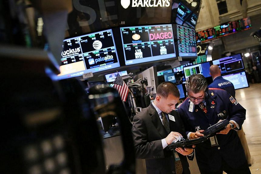 Traders work on the floor of the New York Stock Exchange at the end of the trading day on Aug 1, 2013 in New York City. The Dow and S&P 500 ended at record highs on Thursday, with the S&P 500 rising above 1,700 after strong data on factory gr