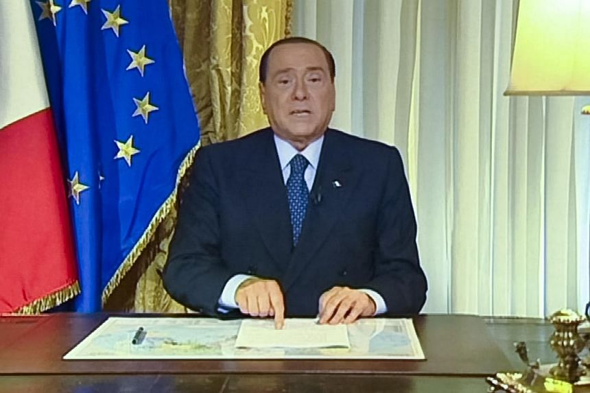 Italian media mogul Silvio Berlusconi appears in this frame grab from an handout pre-recorded video message made available by APTN. Italy's top court on Thursday confirmed a prison sentence forBerlusconi in the first ever definitive conviction in a t
