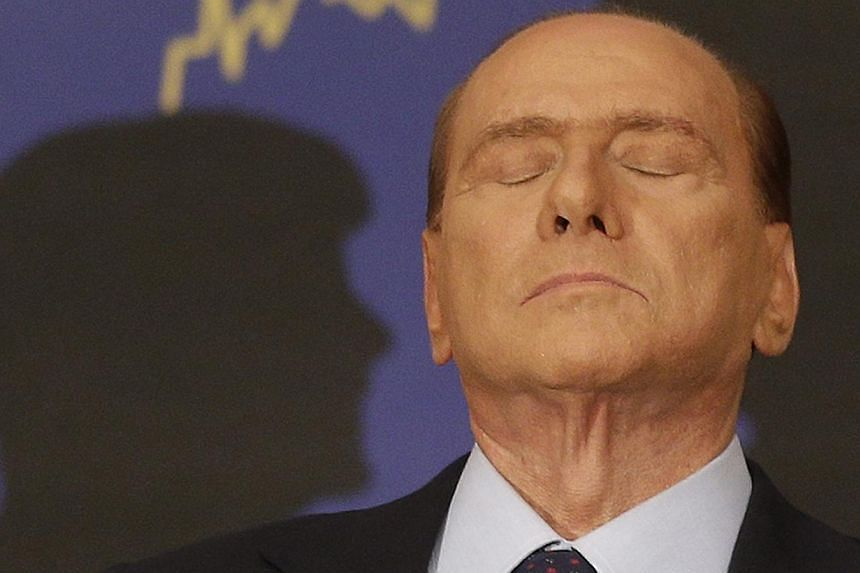 Italian former premier Silvio Berlusconi reacts during a press conference in Rome, Italy on Sept 27, 2012. A ruling by Italy's supreme court upholding a tax fraud conviction against the former premier has left the fate of the country's fragile ruling