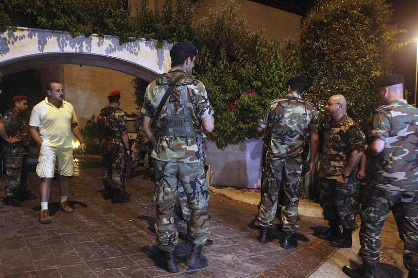Lebanese Army soldiers secure a private residence which was hit by a rocket in Baabda, east of Beirut, on Aug 1, 2013. -- PHOTO: REUTERS