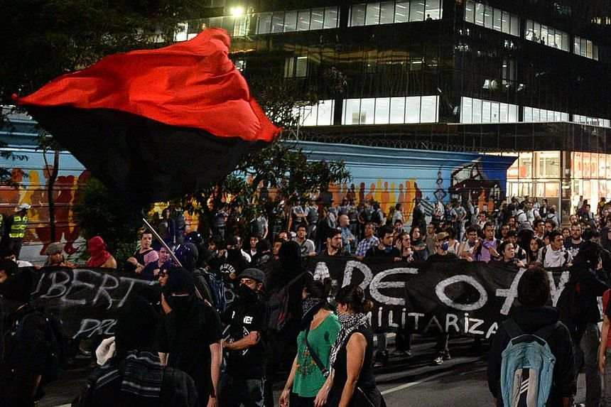 People demonstrate against the disappearance of 42-year-old construction worker Amarildo de Souza who has been missing for two weeks after he was picked up by police at Rio de Janeiro's Rocinha shantytown, in Sao Paulo, Brazil on Augt 1, 2013. -- PHO