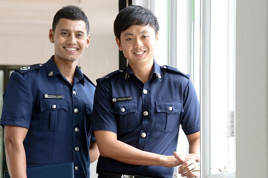 Prison officer Chief Warder (1) Mohamed Faizal Abdul Hamid (left) and patrol officer Staff Sergeant Jonathan Ling are among 32 Home Team officers who were awarded sponsorships for a new degree programme in Criminology and Security at a Ministry