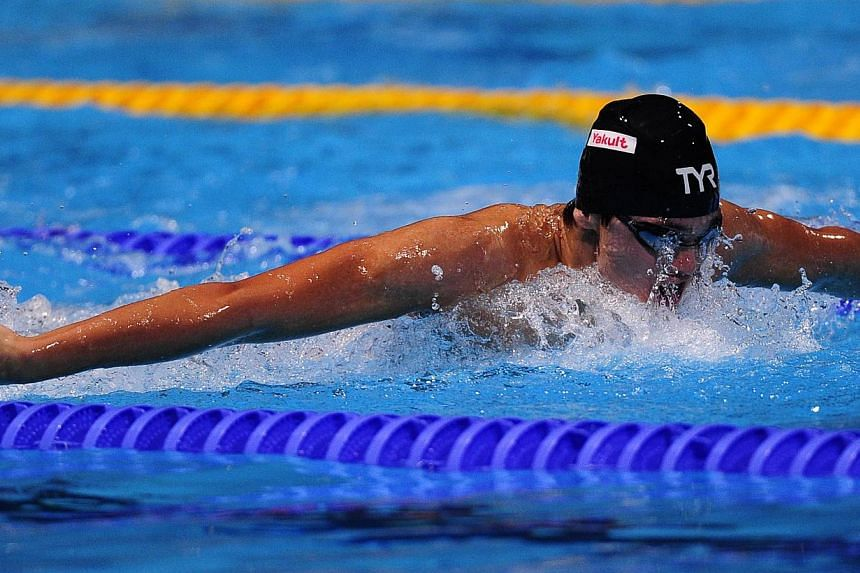 Singapore's Joseph Schooling competes in the heats of the men's 200m butterfly swimming event in the Fina World Championships in Barcelona on Tuesday, July 30, 2013. Schooling narrowly failed to make the last-16 cut in the men's 100m fly. -- PHOTO: A