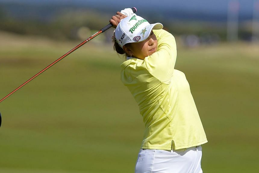 Japan's Miki Saiki tees off at the 17th hole during the women's British Open golf championship at St Andrews in Scotland on Friday, Aug 2, 2013. Saiki had a bundle of new experiences as she surged into the halfway lead on nine-under-par at the women'