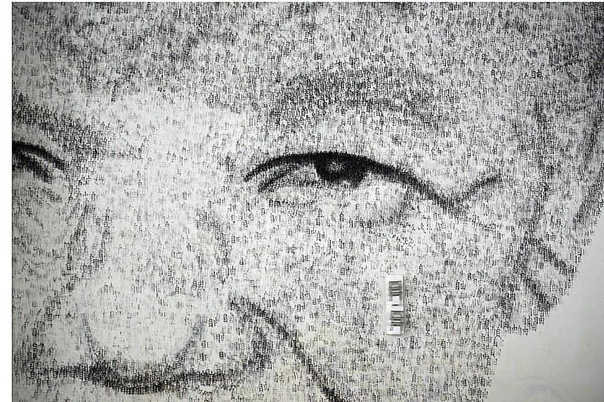 A close up detail of Shanghai-based 34 year-old Belgian artist Phil Akashi's portrait of South African peace icon and former boxer Nelson Mandela, which he forged by pounding the wall 27,000 times with a boxing glove which bore the Chinese character
