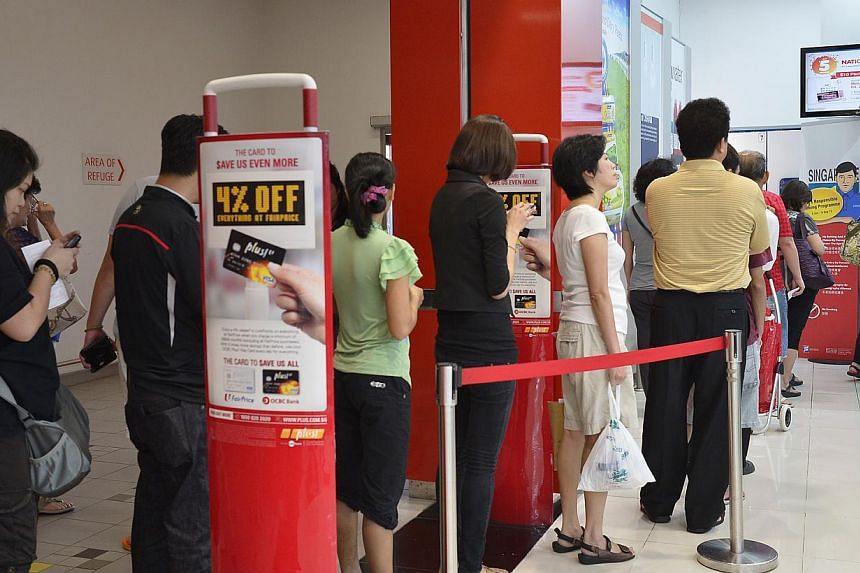 The queue for Toto tickets on Friday, Aug 2, 2013, ahead of the Singapore Pools National Day Draw. One lucky winner walked away with the $5 million jackpot prize. -- ST PHOTO: ASHLEIGH SIM