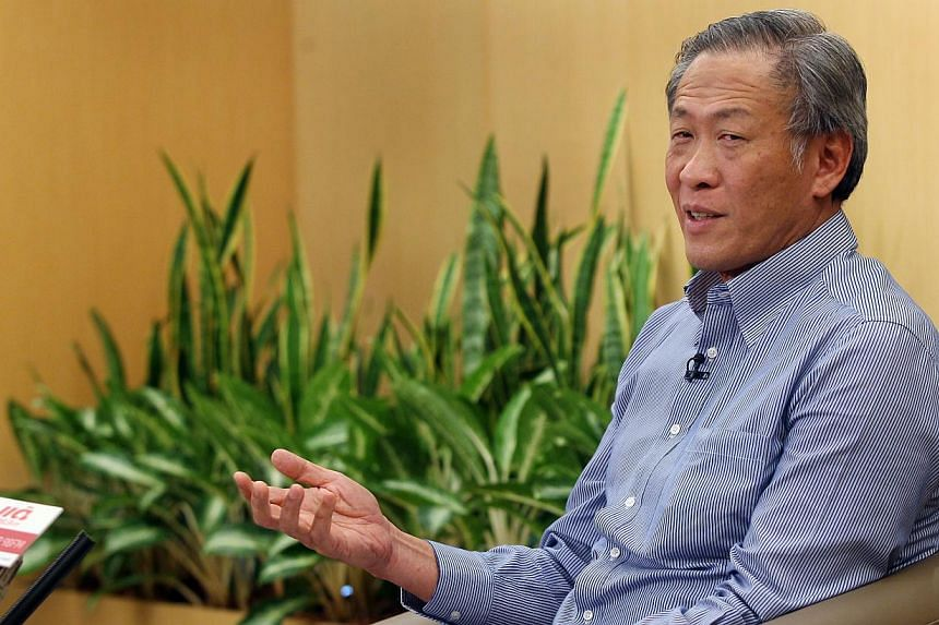 Defence Minister Ng Eng Hen (above) on Friday, Aug 2, 2013, warned of a new threat facing Singapore's Total Defence efforts - distorted or false information, rumours and smears that surface on the internet. -- ST FILE PHOTO: LAU FOOK KONG