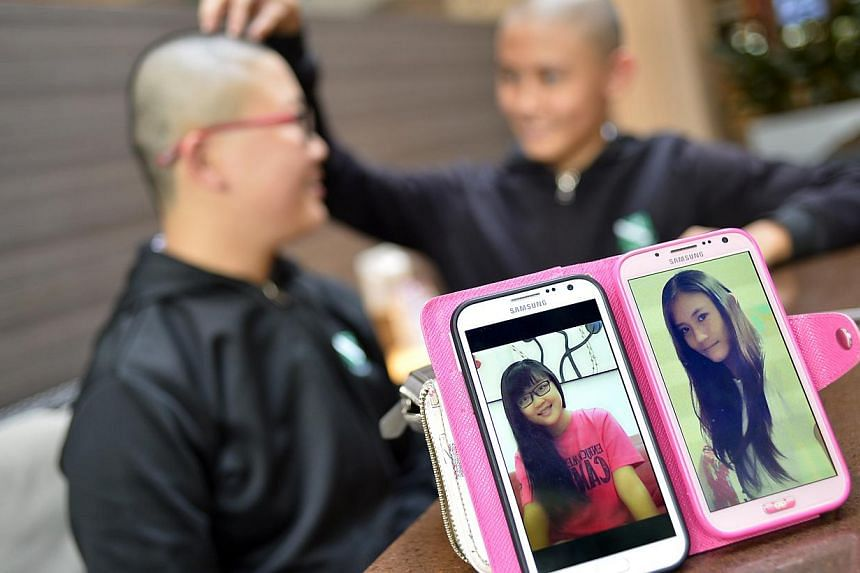 St Margaret's Secondary School students Cherry Wong (left) and Leia Lai, both 15, who took part in last Saturday's Hair for Hope event to raise funds for the Children's Cancer Foundation. A Straits Times report about three St Margaret's