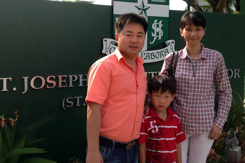 New citizens Xue Rong Gang, 35, and Sia Ai Bee, 40, hope to enrol son Jaydan Xue, six, at St Joseph's Institution Junior in Novena. -- PHOTO: STACEY CHIA