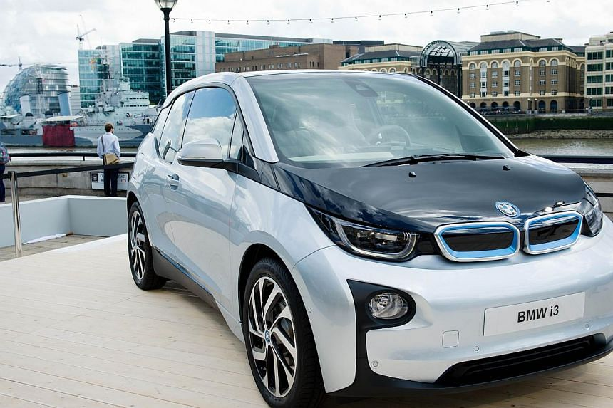 The BMW i3 electric car is unveiled at a photocall in London, on July 29, 2013. The vehicle is the BMW Group's first pure electric series produced model. -- PHOTO: AFP