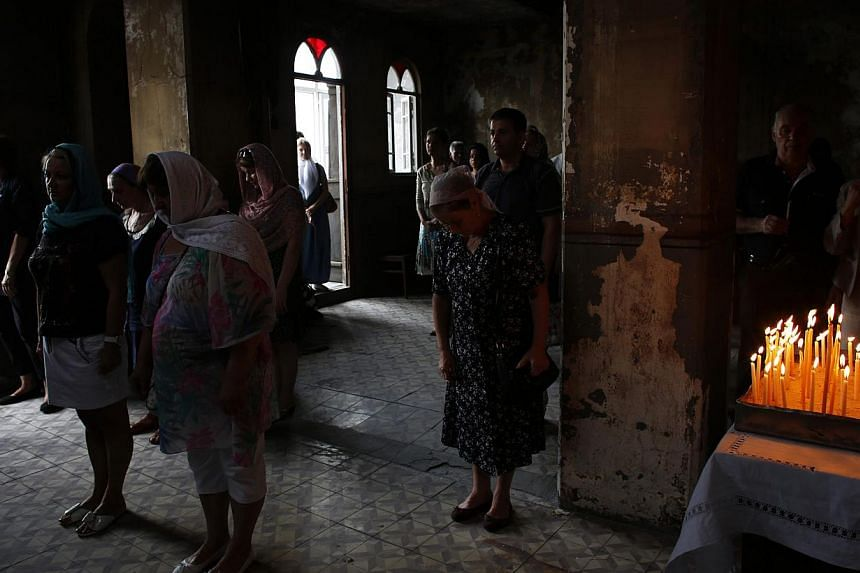 Russian Orthodox worshippers attend a service at St. Elijah Church in Istanbul on Aug 2, 2013. -- PHOTO: REUTERS
