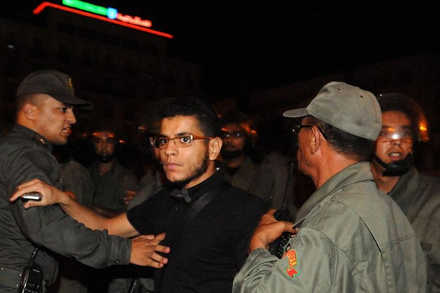 An angry protester shouts slogans during a demonstration on Aug 2, 2013, in Rabat-Morocco, to protest the release of a Spanish paedophile, Daniel Fino Galvan, who raped 11 local children was pardoned by the Moroccan King Mohammed VI. -- PHOTO: