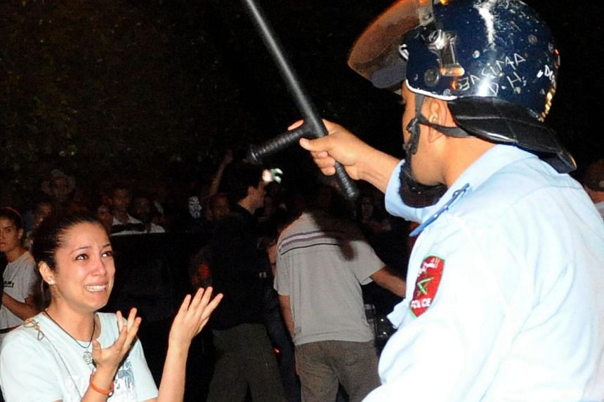 Protesters confront with police during a demonstration on Aug 2, 2013, in Rabat-Morocco on the release of a Spanish paedophile, Daniel Fino Galvan, who raped 11 local children was pardoned by the Moroccan King Mohammed VI. -- PHOTO: AFP