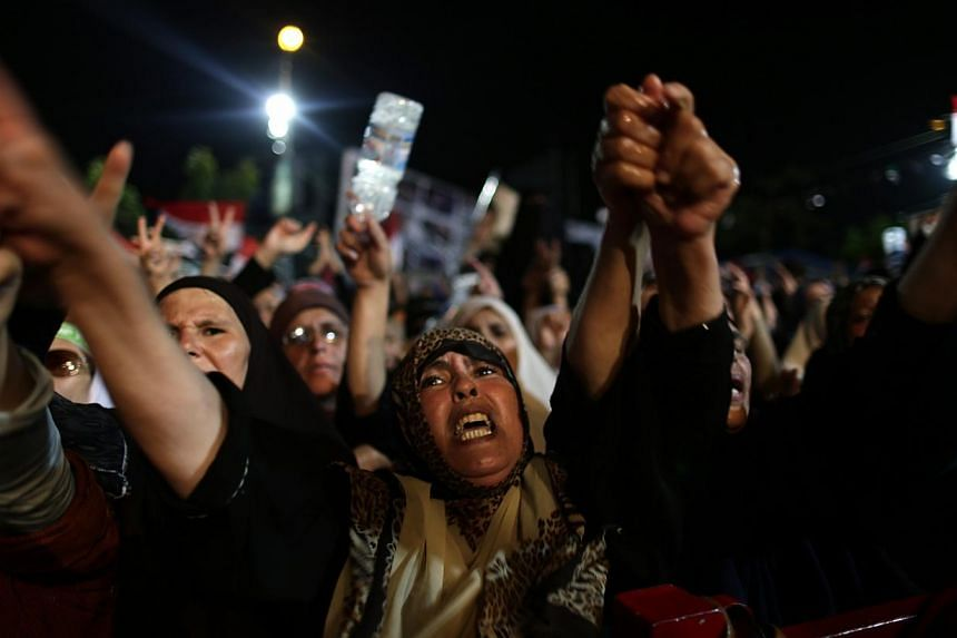 Supporters of Egypt's ousted President Mohamed Mursi chant slogans against Egyptian Defense Minister General Abdel-Fattah el-Sissi outside Rabaah al-Adawiya mosque, where they have installed a camp and hold daily rallies at Nasr City, in Cairo, Egypt