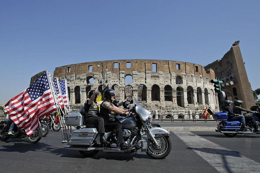 Harley-Davidson motorcycles parade in front of the Colosseum in Rome on Saturday, June 15, 2013. -- FILE PHOTO: AP
