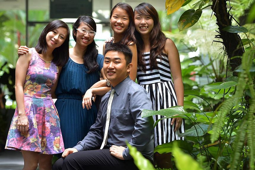SPH journalism scholarship recipients (standing, from left) Jan Lee, Tan Sue-Ann, Cheow Sue-Ann, Lim Jing Wen and (seated) Ma Huaqing were chosen from a pool of 213 applicants. A sixth recipient, Mr Wang Tianjie, is not in the photo. -- ST PHOTO: KUA