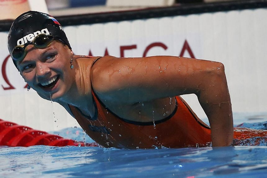 Russia's Yuliya Efimova celebrates after setting a new world record in the women's 50m breaststroke heats during the World Swimming Championships at the Sant Jordi arena in Barcelona on Saturday, Aug 3, 2013. Efimova broke the women's 50m breaststrok