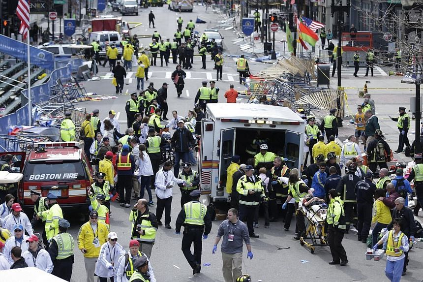 Medical workers aiding injured people at the finish line of the 2013 Boston Marathon in Boston following an explosion on April 15, 2013. -- FILE PHOTO: AP