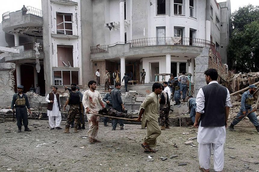 Remains of a dead body being carried away from the site of a suicide attack in Jalalabad province on August 3, 2013. A suicide bomber attacked the Indian consulate in the eastern Afghan capital of Jalalabad on Saturday, Indian officials and local pol
