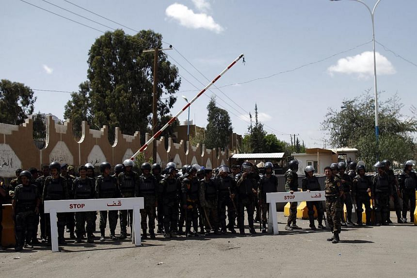 Riot policemen secure the vicinity of the US embassy, during a protest by relatives of Yemenis detained at Guantanamo Bay, in Sanaa on April 1, 2013. US) issued a worldwide warning on Friday that Al-Qaeda may attack in August as it ordered shut its e