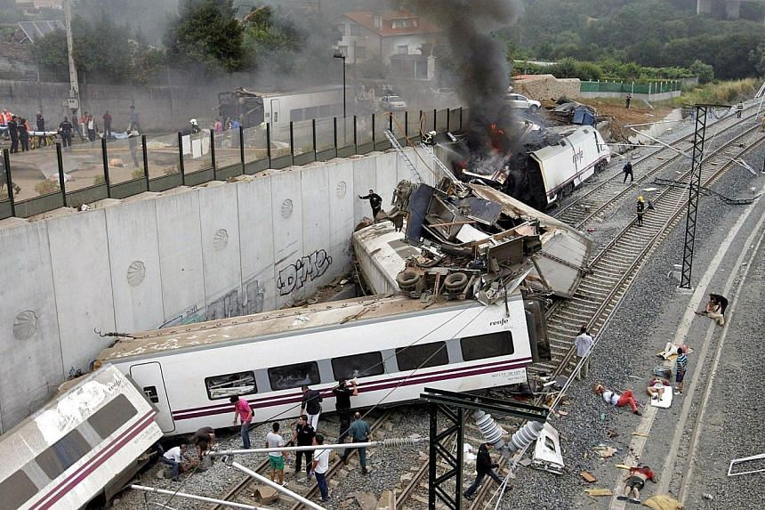 Emergency personnel respond to the scene of a train derailment in Santiago de Compostela, Spain on Wednesday July 24 2013. -- FILE PHOTO: AP