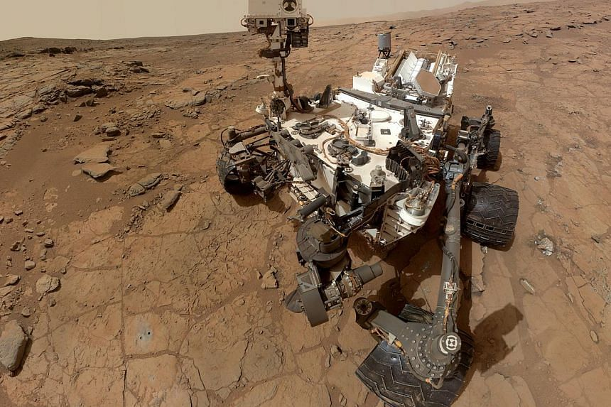 This photo released by NASA shows a self-portrait taken by the NASA rover Curiosity in Gale Crater on Mars. Around 40 volunteers from thousands who applied for a one-way ticket to Mars gathered in the US capital on Saturday to hear from the man behin