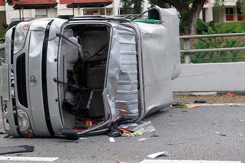 A car driver was arrested on Sunday, Aug 4, 2013, after his recklessness on the road caused a lorry to overturn and left nine injured. -- PHOTO: SHINMIN