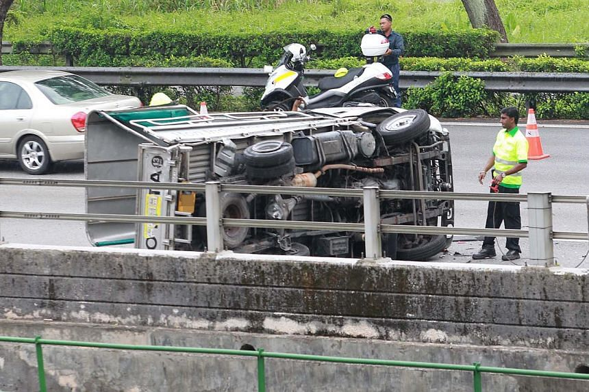 A car driver was arrested on Sunday, Aug 4, 2013, after his recklessness on the road caused a lorry to overturn and left nine injured.-- PHOTO: SHINMIN