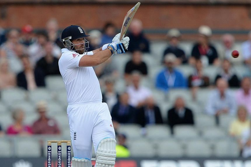 England's Matt Prior plays a shot during the fourth day of the third Ashes cricket Test match between England and Australia at Old Trafford in Manchester, north-west England on Sunday, Aug 4, 2013. England avoided the follow-on on the fourth day of t