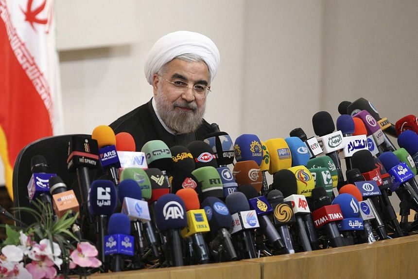 Iranian President-elect Hassan Rohani speaks with the media during a news conference in Teheran on June 17, 2013. Rohani said on Sunday, Aug 4, 2013, the only way for the international community to interact with Teheran on its controversial nuclear p