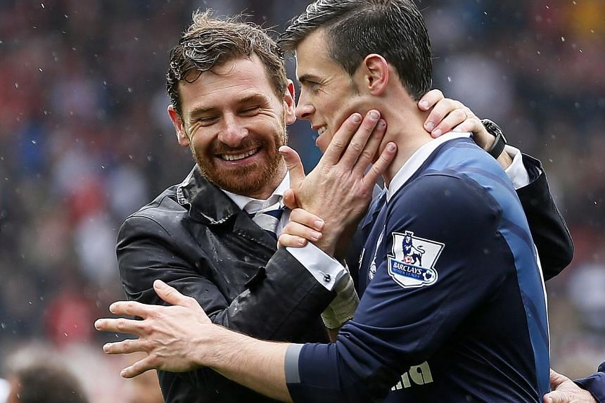 Tottenham Hotspur manager Andre Villas-Boas celebrates with Gareth Bale after winning their English Premier League soccer match against Stoke City at the Britannia Stadium in Stoke-on-Trent, central England, on May 12, 2013.Tottenham boss Andre