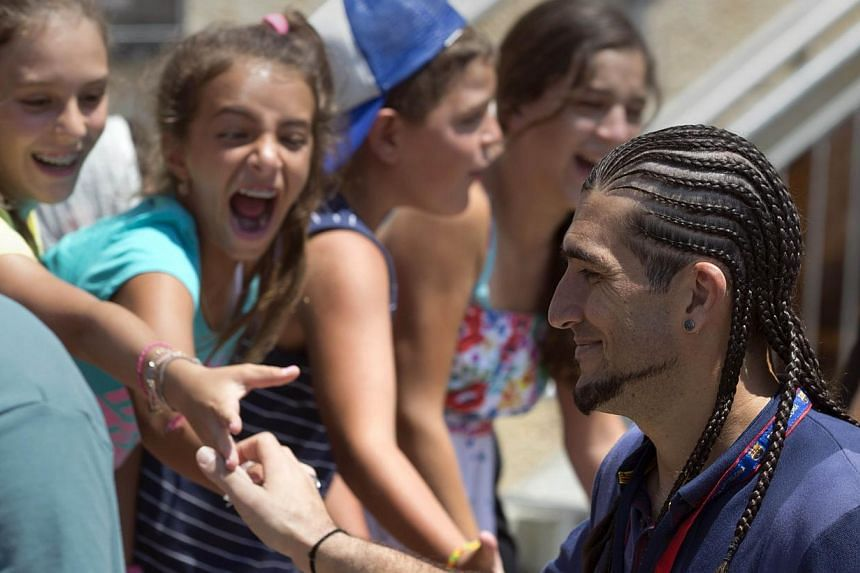 Barcelona's football player, Pinto Jose Manuel, is greeted by Israeli fans during a visit by the football team to the Western Wall in the Jerusalem's old city on Sunday, Aug 4, 2013.Israeli President Shimon Peres on Sunday praised Lionel Messi